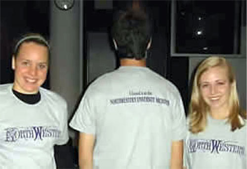 three Leopold Fellows model their new T-shirts reading